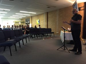 Image of Clayton preaching at Gungahlin